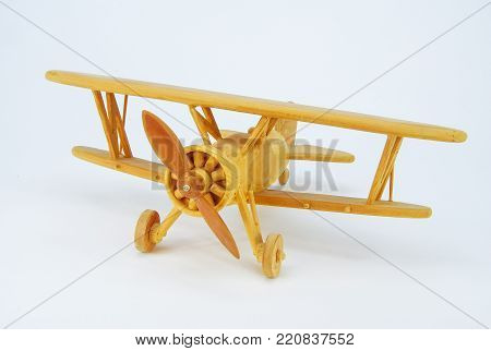 A wooden toy model of a biplane.