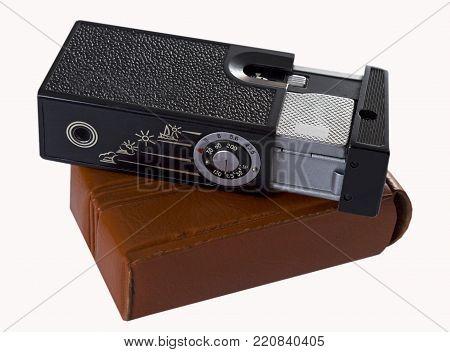 Old miniature soviet camera on white background