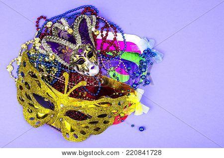 Celebration of mardi gras. Venetian, carnival, masquerade mask, beads. Studio Photo