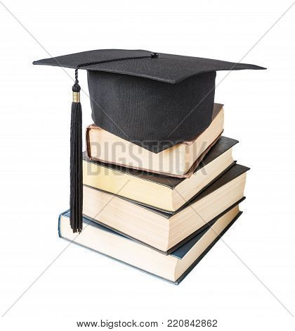 Black graduate (academic) hat on the stack of big books, isolated on white background