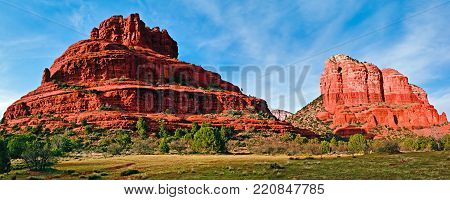 A panorama view of Bell Rock and Courthouse Butte in Sedona Arizona.