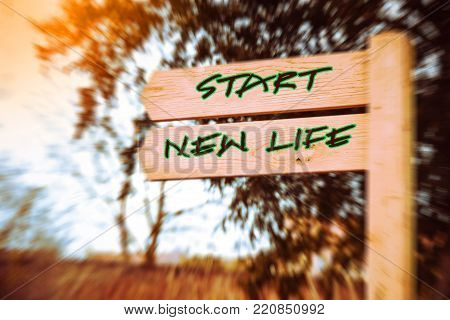 Wooden signpost with two arrows over speed effect backgroun, Start new life signs, Life change conceptual image