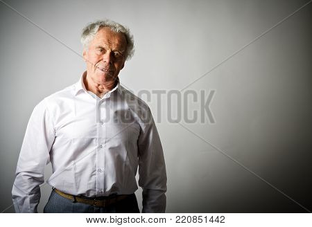 Brave old man in white. Portrait of old professional.