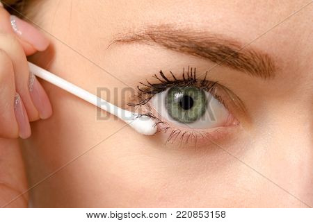 Female eye green cotton swab beauty macro