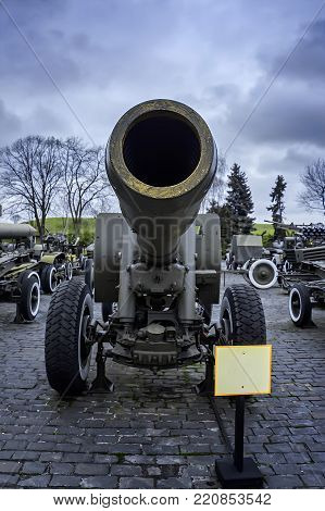 A huge old cannon, a war. Military equipment