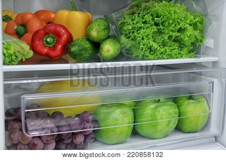 Fresh vegetables and fruits in refrigerator