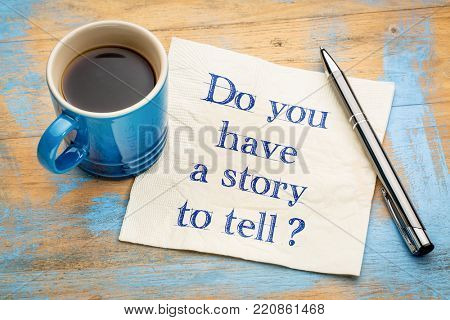 Do you have a story to tell? Handwriting on a napkin with a cup of espresso coffee
