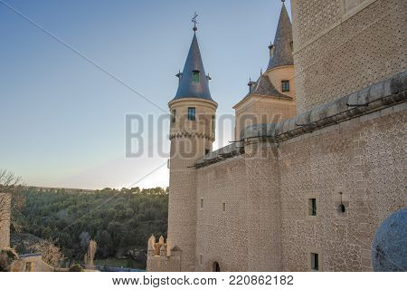 Partial view of the Alcazar of Segovia its towers the forests that surround it and the river Eresma Community of Castilla y Leon Spain