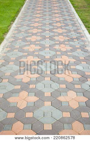 Bricks Foot Path In The Garden Background.