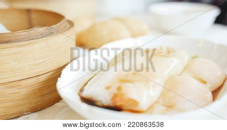 Eating steamed dim sum in Chinese restaurant