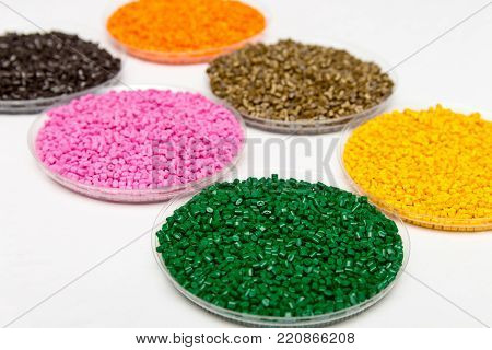 Plastic Pellets . Colorant For Polymers In Granules. Plastic Pellets In The Hands With Gloves And Tw