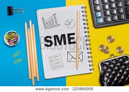 Small and Medium Enterprise, SME notes in the notebook on the Desk of a businessman in office. Business concept SME.
