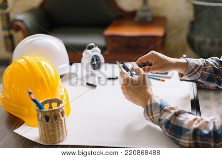 Construction Project On Drawing Table With Engineering Tool In Office. Construction Engineering.sele