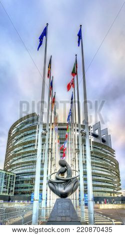 Strasbourg, France - December 5, 2017: Flags of European countries at the Louise Weiss building of the European Parliament.