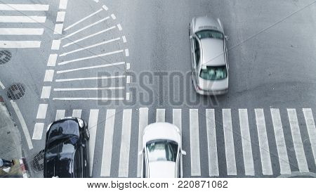 the car transport go pass on street pedestrian crossroad in the city street ,from top view ,bird eye view.