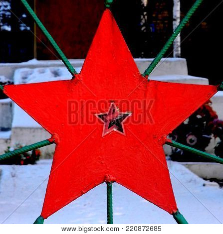 Communist red star in the park close up view