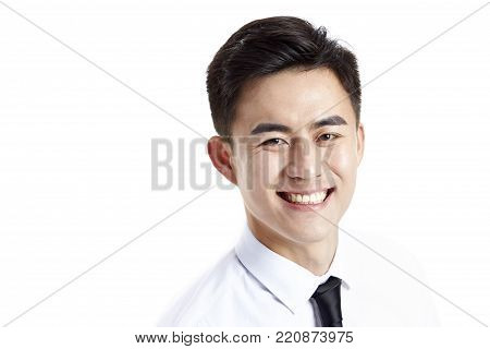 studio shot of a young happy asian business man looking at camera with toothy smile, isolated on white background.