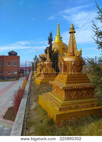 A golden buddhist monuments around Datsan Rinpoche Bagsha monastery in Ulan-Ude, Russia
