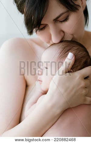 mother's love tenderness kiss newborn baby concept. family values. moments of happiness.