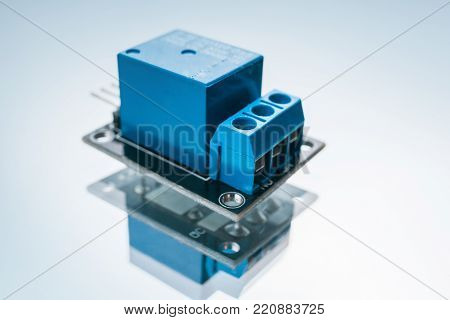 electronic relay on a white background. device for closing and opening an electrical circuit. microelectronics science.