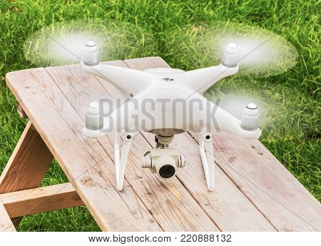 Wallisellen, Switzerland - 19 September, 2017: a Phantom 4 Pro drone standing on a wooden table. Phantom 4 Pro is a consumer drone, designed and manufactured by the DJI company.