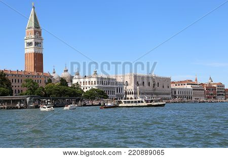 Venice, Italy - July 14, 2016: Saint Mark Bell Tower And The Ancient Ducal Palace