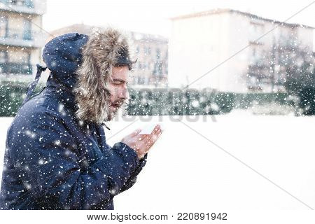 Portrait Of Man Feeling Very Cold Under Snowy Weather
