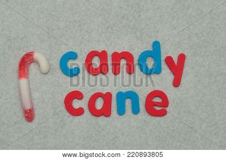 The word candy cane with a candy cane on a white background