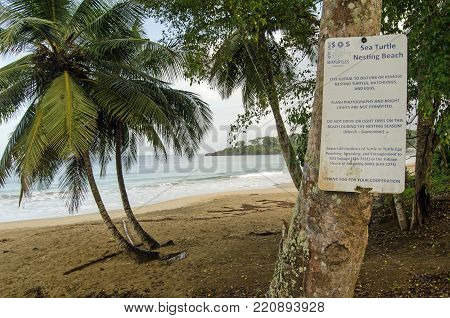 STONEHAVEN, TRINIDAD AND TOBAGO:  JANUARY 6, 2018:  Sign at Stonehaven Bay on the Caribbean Island of Tobago warning that the beach is one of the few nesting sites of the endangered leatherback turtles.  Viewed from public road.