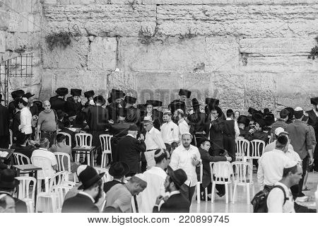 JERUSALEM, ISRAEL - AUGUST 06, 2010: Black and white picture of jewish orthodox  praying in front of the Western Wall in Jerusalem, Israel.