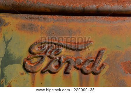EAST GRAND FORKS, MINNESOTA, October 7, 2017: The rusty Ford  truck hood logo is a product of the Ford Motor Company located in Dearborn, Michigan started by Henry Ford and incorporated on June 16, 1903