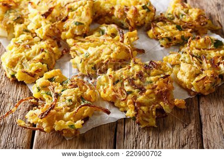 Crispy Onion Bhajis Vegan Snack Or Starter With Yogurt Close-up. Vertical