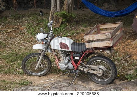 Classic retro mini motorcycle at outdoor on mountain at Pha Taem National Park in Ubon Ratchathani, Thailand