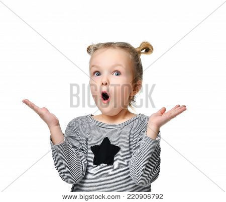 Young girl kid surprised and shocked with open mouth looking up hands spread isolated on a white background