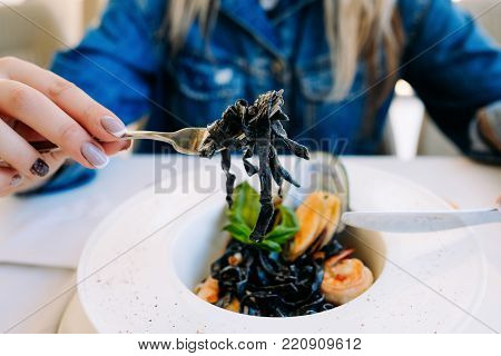 tasting restaurant seafood black pasta concept. traditional kitchen. national cuisine. delicious delicacy.