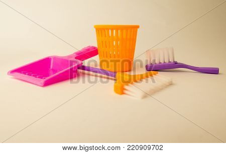 Background About Cleaning With Color Brush, Dustpan And Garbage Can