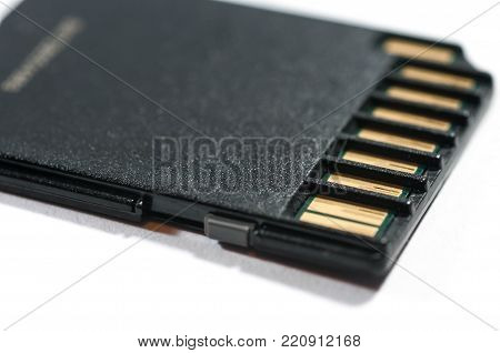 SD card close up macro shot isolated on white background.