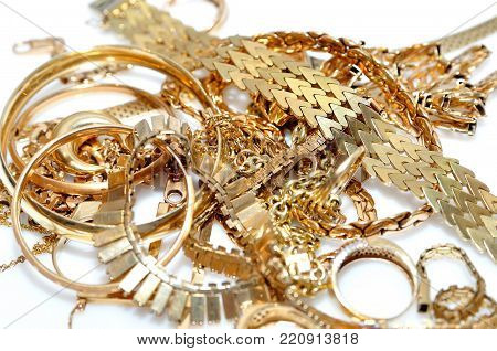 Stack of gold jewelry isolated on white background. poster