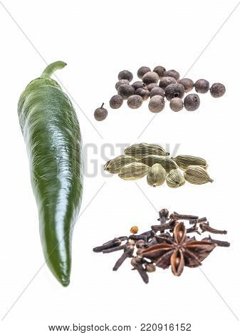 Composition of chilli peper, anise, cardamom and allspice on white background