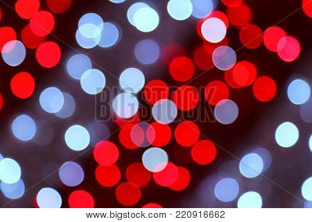 Unfocused bright colorful holiday lights in evening background