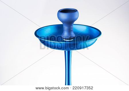 Upper part of a hookah, a bowl for tobacco of blue color, isolated on a white background. Modern blue hookah. Eastern smokable water pipe smoking. Still life