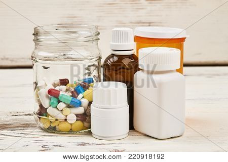 Bottles and prescription medications. Cure for sickness and pain. Modern health care and pharmacy.