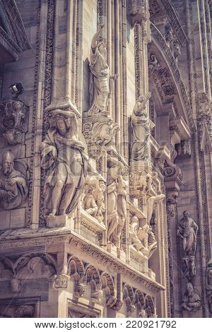 Detail of the facade of Milan Cathedral (Duomo di Milano) in Milan, Italy. Milan Duomo is the largest church in Italy and the fifth largest in the world.