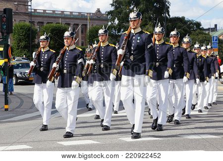Stockholm, Sweden - August 13, 2013: The royal guards parade marching to the royal palace for change of guards cermony.
