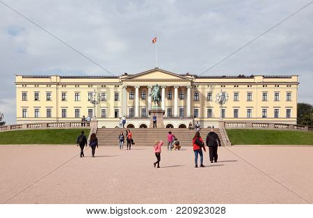 Oslo, Norway - September 16, 2016: View of the Oslo royal palace exterior  with people walking.