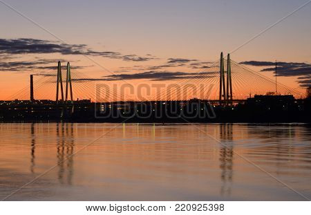Cable stayed bridge on the outskirts of St. Petersburg at sunset, Russia.