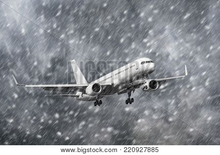 Airplane approaching on a landing in snowstorm bad weather
