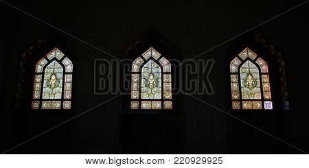 BANGKOK , THAILAND - DECEMBER 19, 2017 : Panorama  of Thai art on window of Church at Wat Benchamabophit, One of Bangkok's most beautiful temples is also known as