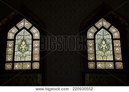 BANGKOK , THAILAND - DECEMBER 19, 2017 : Thai art on window of Wat Benchamabophit, One of Bangkok's most beautiful temples is also known as