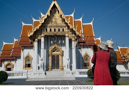 BANGKOK,THAILAND-DECEMBER 19, 2017: Tourists visited at one of Bangkok's most beautiful temples is the Wat Benchamabophit, also known as